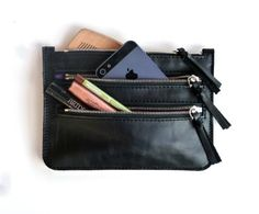Black leather wallet with three zippered pocket, with silver colour zippers,leather pullers. The smallest pocket is perfect for your money, cards, or for