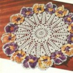 Free pansy doily crochet pattern - simple, step-by-step instructions included to make this vintage crochet doily.