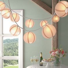 A nylon globe lantern diffuses light from an incandescent bulb, creating statement making appeal in your abode. Paper Lantern Lights, Lantern String Lights, Globe Lights, Paper Lanterns Bedroom, Patio Lighting, A Table, 3 D, Dream Bedroom, Master Bedroom