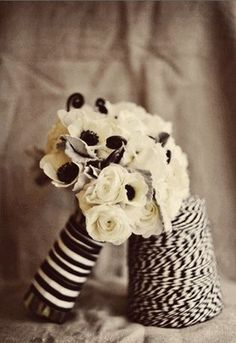 Black + White anemones, ranunculus, and fiddleheads - delicate but very beautiful! #wedding #bouquet