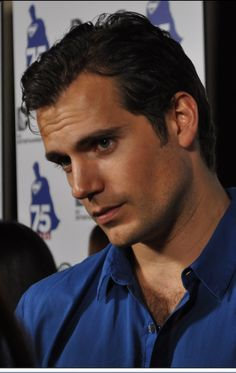 """Henry Cavill. Again with the """"I'm really listening"""" look."""