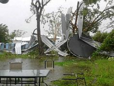 WILD WEATHER: A ute (left) sits suspended and (right) the remnants of a shed blown into a neighbour's yard during a tornado. Widebay Burnett, Bundaberg Floods & Tornadoes January 2013