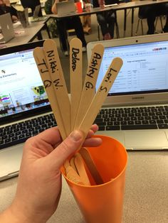 Staff names on a stick for staff meetings. Every time we meet we have two norm knockers, 2 note takers, and one time keeper!