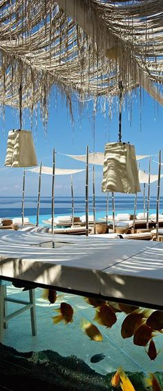 The Aquarium Bar by the infinity pool at the Cavo Tagoo Hotel, Mykonos  http://www.mediteranique.com/hotels-greece/mykonos/cavo-tagoo/