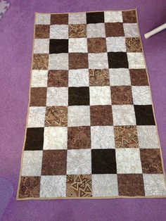 """Simple table runner from 5"""" squares. Quilted buy me. Made for my son."""