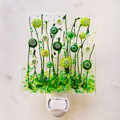 """This sweet and simple green flower glass nightlight is sure to add a touch of warmth and character to any room. Our signature field of flowers night lights are meticulously crafted with glass paints, crushed Italian glass and genuine Murano millefiori. The piece is then """"tack fused"""" in a 1300 degree kiln which results in a highly textural and dimensional effect, then carefully annealed (cooled) for strength and durability. This listing is for one single nightlight, coordinating items such as… Fused Glass Art, Stained Glass Art, Stained Glass Night Lights, Glass Fusion Ideas, Glass Fusing Projects, Nightlights, Bottle Painting, Glass Flowers, Yellow Flowers"""