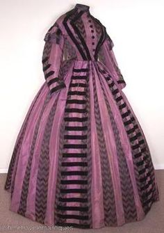 Lovely purple silk gown with black velvet trim I would say dress dates from around 1863-65 and is in great condition. From Kay Krewer collection.