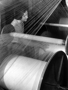 Weaver at the American Woolen Co., Lawrence, MA by Margaret Bourke-White.