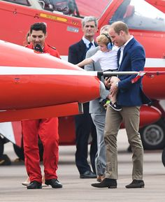 Prince William, Duke of Cambridge shows Prince George of Cambridge a red arrow plane as they attend the The Royal International Air Tattoo at RAF Fairford on July 8, 2016 in Fairford, England.
