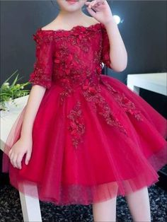 She will be the talk of this year's family holiday card. This gorgeous dark reddress has a half-sleeve off the shoulder silhouette. Its alsocovered with flowerappliques and the flared skirt is perfect for twirling in.She is guaranteed to look like perfection. Style it with dressy shoes and gold hair accessories. Fo Halloween Tutu Dress, Costume Dress, Dark Red Dresses, Girls Hairdos, Cheap Baby Clothes, Gold Hair Accessories, Blue Party Dress, Coloring Pages For Girls, Prom Girl