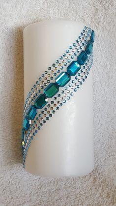 Turquoise rhinestone candle from welshwaxesandcrafts.co.uk