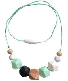 Whether for a birthday, Christmas, Mother's Day, or a regular ol' day of new motherhood, get inspired by shopping some of our best gifts for new moms. New Mommy Gifts, First Mothers Day Gifts, Great Gifts For Mom, Gifts For New Moms, Teething Necklace For Mom, Baby Diy Projects, Best Gifts, Beaded Necklace, Clever