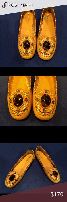 🌞Prada Leather Moccasins🌞 Worn Once 🌞 Excellent Condition        Deep yellow leather with gold stitching. On the toe is an oval stone surrounded by 4 amber rhinestones                         Leather soles                                            Size 39.5                                                🌞🌞🌞🌞🌞🌞🌞🌞🌞🌞🌞🌞🌞 Prada Shoes