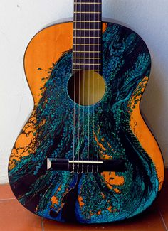 I can't stop thinking about this beautiful guitar...time to paint one of my own!