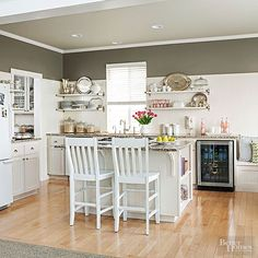 White+beaded+board+covers+the+backsplash,+but+stops+short+of+the+ceiling,+allowing+a+rich+shade+of+taupe+paint+to+warm+up+the+mostly-white+room.+The+classic+backsplash+choice+is+the+perfect+addition+to+a+cozy+cottage+kitchen.
