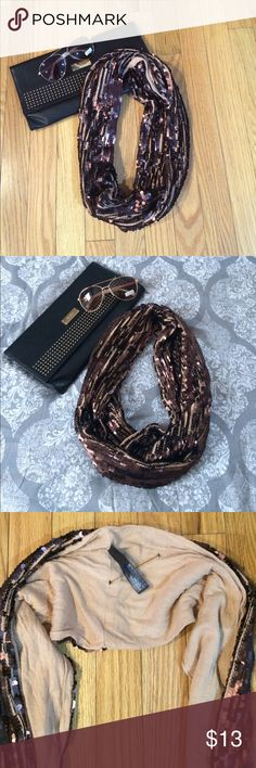 Express Brown Sequin Wrap Around Infiniti Scarf Beautiful Express brown wrap around Infiniti sequin scarf!! Inside of scarf is a light brown cotton material and outside has the sequins!! So when you around it looks really nice with both sides showing!! A beautiful scarf to dress any outfit up!! New - never been worn!! Message me with any questions! ❤️ Express Accessories Scarves & Wraps