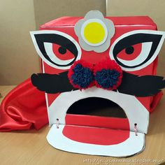 DIY your own Chinese Lion Head using a carton box Chinese New Year Crafts For Kids, Chinese New Year Dragon, Chinese New Year Activities, Chinese New Year Decorations, Chinese Crafts, Art For Kids, New Year's Crafts, Diy Arts And Crafts, Chinese Lion Dance