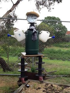 "St Joseph The Worker Primary School, VIC. Our inspirational Enviroweek quote is ""Recycle to Revive."" We created a veggie patch and a recycled scarecrow that will water our garden with rain water. #enviroweek13"