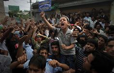 Srinagar, India: A Kashmiri boy shouts slogans during an anti-India protest
