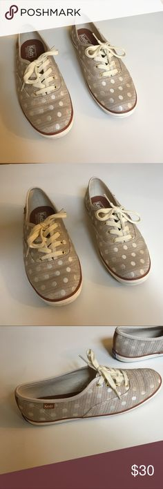 Keds polka dot tennis shoes Size 7 1/2. Comes with two sets of laces. Worn once and in new condition. Keds Shoes Sneakers