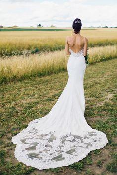 Bride wears a backless Enzoani lace dress. Photography by Nina Wernicke #backlessweddingdress #backlessweddinggown #backlessbridalgown #bridaldesigner #weddingfashion #weddingstyle
