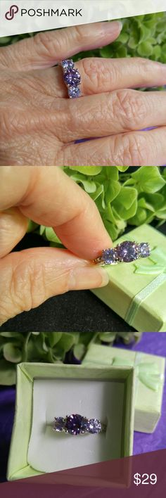 NWOT  2 CT Amethyst and White Topaz Size 6 NWOT   2 CT Amethyst and White Topaz Set in Genuine Solid Sterling Silver stamped 925. Center amethyst with 1 smaller amethyst and 3 smaller white topaz on either side.  Size 6. Listed 8/2/2016. Jewelry Rings