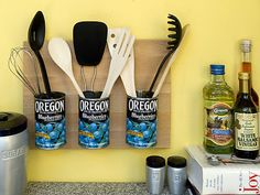 """) """"Hot glue heavy-duty magnets to ten soup cans and stick them to a steel cookie sheet. Hang it within kids' reach using a plate hanger. Use the cups to hold crayons, chalk, markers and even Legos. Label the cans for easy clean up."""""""