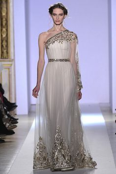 [Look at her eyes. Zule from Ghostbusters, perhaps? And look at that poor woman's neck and collar bones. On another topic, I like the silver trim on this gown.] 2013-couture-wedding-dress-inspiration-from-zuhair-murad-18-original