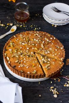 This Baklava Frangipane Tart is a merging of cuisines. Italian Frangipane and Middle Eastern Baklava combine to make a tender, nutty and luscious tart. #baklava #frangipanetart #honeytart