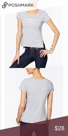 Michael Petite Graphic T-shirt Go for off-duty cool with this stylish petite graphic-print T-shirt from Michael Michael Kors. Scoop neckline. Pullover styling. Graphic print at front; logo graphic at left front hem. Vents at side hems. Hits at hip. Cotton Michael Kors Tops Tees - Short Sleeve