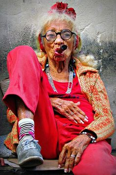 While waiting for her mojito, la Abuela kicks back on her veranda with a good Cuban cigar...