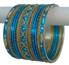 Bollywood Fashion Indian Bangles Turquoise and Golden Stud Bracelet Set Product Code :Indian Bangles Set 55 The Bangles Set Contains 26 individual Bangles Colors & Design: (As Per Images) Quantity: 1 Bangles Set Base Material : Alloy Metal & Lac decorated with different stones and Kundan and Age Group : Adult,Kids Price $USD   11.95