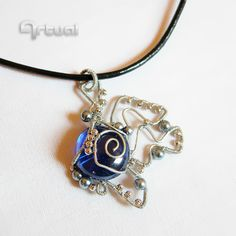 Wire wrapped pendant with pearls and blue glass cabochon