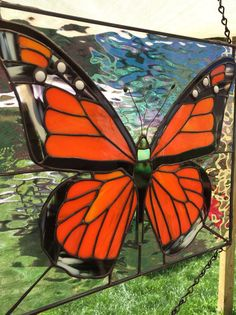 Stained Glass Monarch Panel This pic Does the piece no justice! Its a must see in the sun. Zinc frame and chain included! Iridescent water used for the outside glass. 12x12 and zinc frame and chain included. We love custom orders..... If you cant find what your looking for just ask we