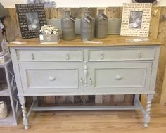 This Sideboard has been hand painted in After Rain Autentico Vintage Chalk Paint and waxed for protection with a little distressing.  The top has been sanded back to the natual wood and waxed.