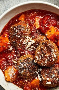 Cooked until fluffy and dry like couscous, fonio, a West African staple grain, keeps the meatballs tender while imparting a mildly nutty, earthy flavor. These meatballs are on the delicate side—let them chill before cooking, and sear them on all sides to help them hold together during the final simmer in the sauce.#soup #souprecipes Oven Baked Meatballs, How To Cook Meatballs, Best Soup Recipes, Wine Recipes, Cooking Recipes, Barbecue Recipes, Barbeque Sauce, Smoked Pork Ribs, Stewed Potatoes