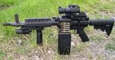 """The Ares """"Shrike"""" advanced weapon system came from an attempt to create a dedicated a 5.56 belt-fed upper receiver module for the versatile and highly popular M16 / Ar-15 line of rifles. It is manufactured in USA by Ares Defense Systems, Inc. See more on YouTube: http://www.youtube.com/watch?v=3TWnR4ckORg"""