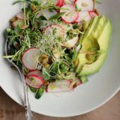 Avocado, Radish + Sprout Salad with Tangy Miso Dressing  1/2 cup extra virgin olive oil 1/4 freshly squeezed lemon juice 1 1/2 tablespoons white or yellow organic miso paste 1 tablespoon raw honey (or brown rice syrup/maple syrup) 1-2 tablespoons water 1 tablespoon tahini  Salad  4 cups mixed sprouts 1 bunch pink radishes, thinly sliced 1 ripe avocado, halved and thinly sliced 2 green onions, thinly sliced 1/4 cup pumpkin seeds 1/4 sunflower seeds