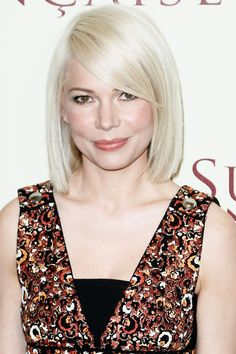 The cut—which falls below the chin but above the shoulders—frames the actress' face just so thanks to a long and thick side bang.   - HarpersBAZAAR.com