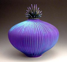 A thrown and carved porcelain vessel by Vermont artist Natalie Blake. Spectacular ~ saturated colors and organic forms... more at her website -  http://natalieblake.com/