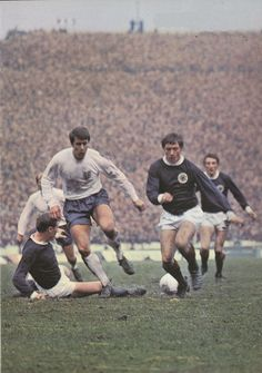 24th February 1968. Scotland duo Billy McNeil and Willie Johnston combine to stop England's Geoff Hurst, at Hampden Park.