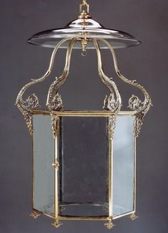 A Regency Period Hexagonal Brass Lantern  The crown with scrolling cast arms decorated with finely cast acanthus leaves. The door with knob handle and the base with inverted flower head finials.  English, Circa 1815  Shrubland Park, Suffolk The lantern possibly bought during the early 19th century enlargement of the house by Sir William Middleton