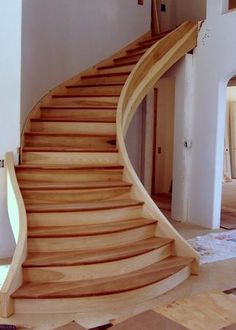 Like the way this staircase turns a little and gets wider at the bottom. Paint top of stairs darker color and base/bottom of each stair lighter (maybe white). Do tops of stairs same color as hard wood floor they go up/down to.