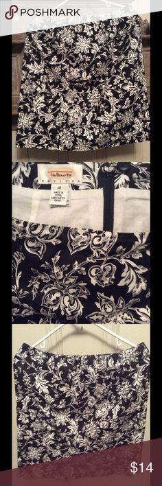 Talbots Cotton Skirt Size 10 Petite Black/White Floral cotton skirt. Zips up the back. Size 10. Petite. Knee length. Straight Talbots Skirts