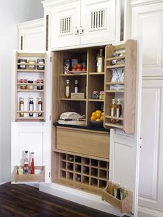 The larder makes a comeback and serves as a pantry in modern kitchens. Beautiful cream larder with oak interior and granite countertop / worktop Kitchen Larder Units, Kitchen Pantry, Kitchen Dining, Kitchen Cabinets, Kitchen Ideas, Clever Kitchen Storage, Kitchen Storage Solutions, My Ideal Home, Modern Kitchens