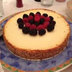 Lemon vanilla cheesecake with almond matzo crust, topped with raspberries and blackberries. 1st cheesecake ever! :)