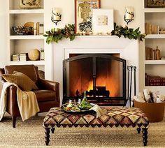 I would love some built ins on either side of our mantle. That and a new fireplace. A lovely leather chair. MMMMMM