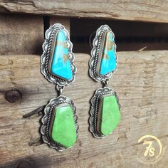 Gallup Earrings - Navajo handcrafted turquoise drop earrings. Entricate scallop detailed sterling silver setting and borders. Sterling silver rope trim setting. Kingman and Gaspeite Turquoise stones.