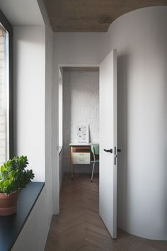Rounded corners to save space in Moscow apartment.