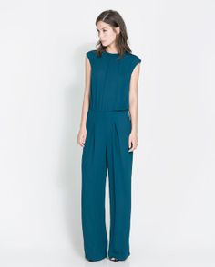 OPEN-BACK JUMPSUIT from Zara. I am such a Zara fan! They make great basics that I love to layer with my wild accessories!
